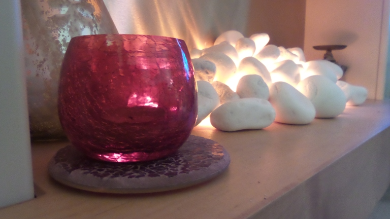 One day I'll have my log burner but for now my pretty lit of stones will do!